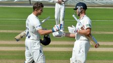 Sam Hain is congratulated on becoming English county cricket's youngest-ever double centurion