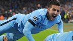 Manchester City's Sergio Aguero (bottom) celebrates scoring his sides third goal of the game alongside teammates Frank Lampard and Stevan Jovetic (left) during the Uefa Champions League match