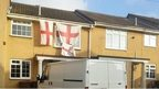Flags on house