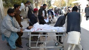 Pakistani volunteers shift an injured polio female health worker at a hospital in Quetta on November 26, 2014.