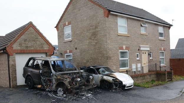 Two of the cars damaged by fire