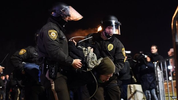 Police arrest a protester in Ferguson, Missouri, 25 November 2014