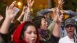 """Demonstrators raise their hands and shout """"hands up, don't shoot"""""""