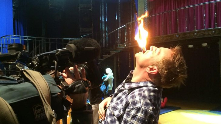 Brian Conley performing fire trick
