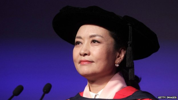 China's First Lady Peng Liyuan at a conferment ceremony of an honorary doctorate on her at Massey University  in Wellington, New Zealand (20 November 2014)