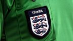 FA badge on referee's shirt