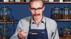 Sebastian Michaelis, a master blender, tasting tea.
