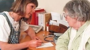 GP talking to patient