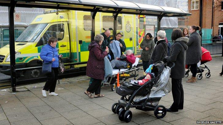 Woman with ambulance on street