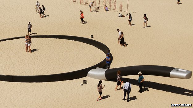 "A sculpture called ""We're fryin' out here"" at a beach in Sydney"