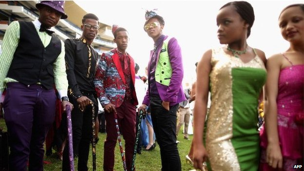 Racegoers participate in a fashion competition during the Durban July horse races on 6 July 2013 in Durban, South Africa