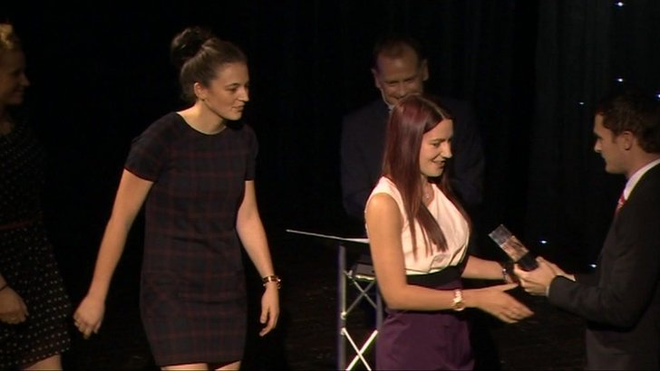 Women collecting award