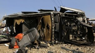 The wreckage of a British embassy vehicle after a suicide attack in Kabul, 27 November 2014