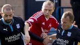 Dundee's Gary Harkins (left) and David Clarkson (right) squeeze out Willo Flood
