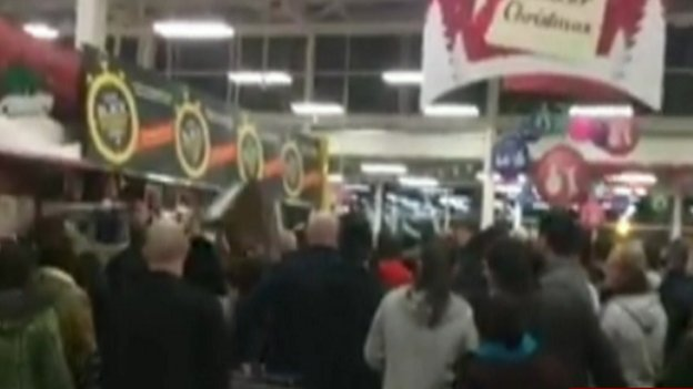 A crowd in a Tesco shop in Trafford, Manchester