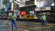 Workers spray a road, previously occupied by pro-democracy protesters, after police completed their clearance of a major protest site in the Mongkok district of Hong Kong on November 26, 2014.