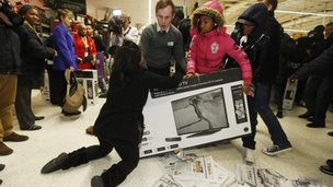 Shoppers fight over a TV in a supermarket