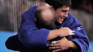A judo coach and his judoka