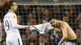Roberto Soldado confronts a pitch invader