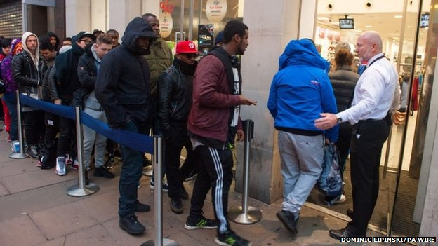 People queue outside a branch of Foot Locker on Oxford Street