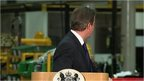 David Cameron glances over his sholder