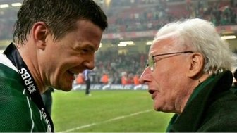 Jack Kyle with Brian O'Driscoll after Ireland completed the Grand Slam in Cardiff in 2009
