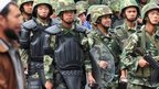 Armed Chinese soldiers march in Urumqi on July 15, 2009 in northwest China's Xinjiang province