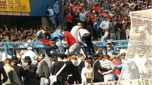 Fans climbing out of the terrace pens