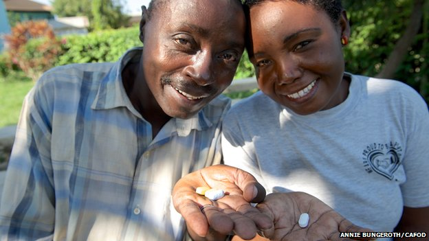 David and Margaret holding ARVs in Mombasa, Kenya
