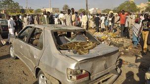 People gather at scene of bombing in Kano - 28 November