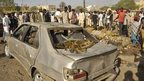 People gather at scene of bombing in Kano - 28 November