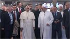Pope Francis is shown around the Blue Mosque