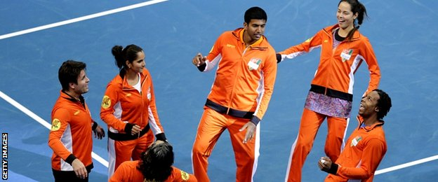 Indian Aces team (R-L) Gael Monfils of France, Ana Ivanovic of Serbia, Rohan Bopanna of India, Sania Mirza of India and Fabrice Santoro of France dance as they celebrate