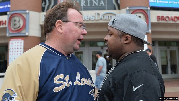 A protestor argues with a Rams fan outside the St Louis stadium on Sunday.