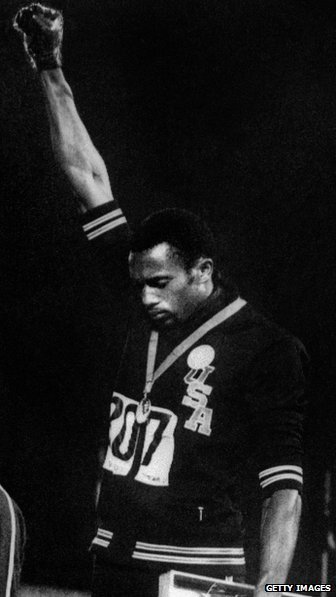 Tommie Smith raises his right arm in protest during the 1968 Olympics.