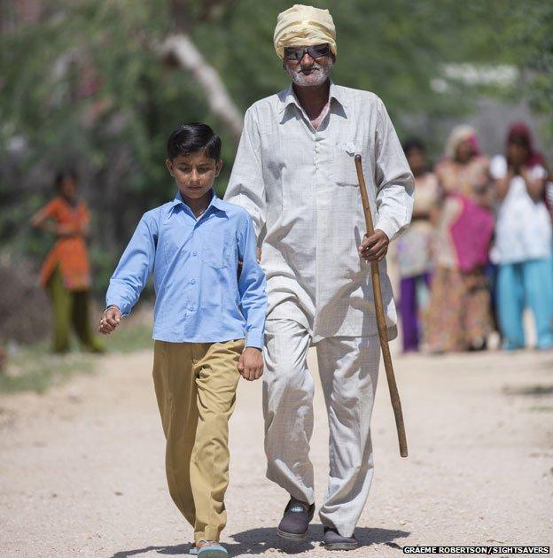 Shangkarlal Bishnoi walking with his grandson