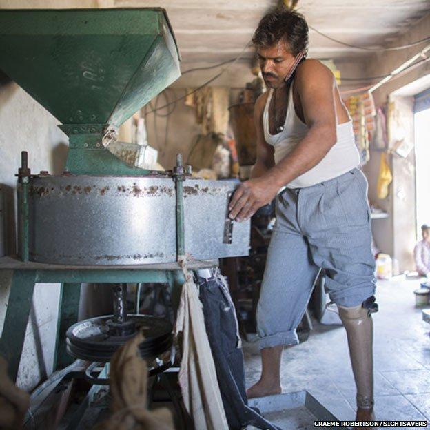 Bhagarath working in the flour mill