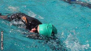 A triathlete swimming