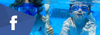Image of two boys under water with