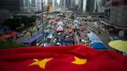A folded Chinese flag is seen at the pro-democracy movements main protest site in the Admiralty district of Hong Kong on December 2, 2014