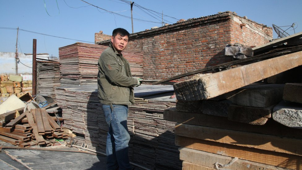 Zhang Bang Long. a villager from Shandong province, carries materials in Dong Xiao Kou village