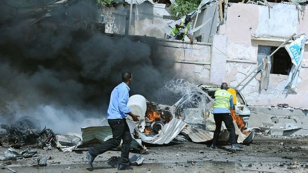 Somali security forces rush to the site of a blast near the heavily fortified gates of the airport in Mogadishu on 3 December 2014