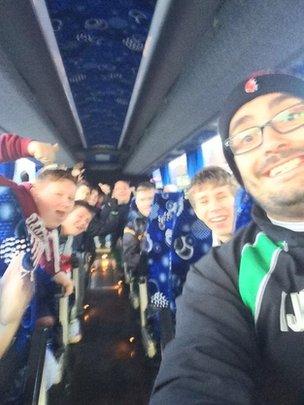 Iain and the team on the bus