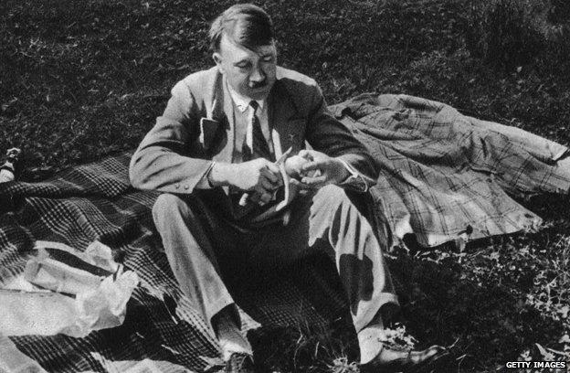 Hitler eating at a picnic