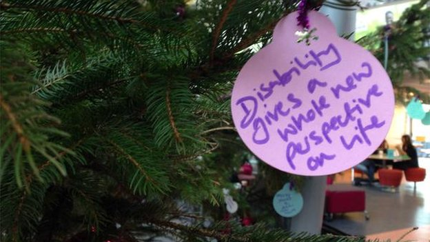 """Matt Davies' picture of a bauble on a xmas tree saying """"disability gives a whole new perspective on life"""""""