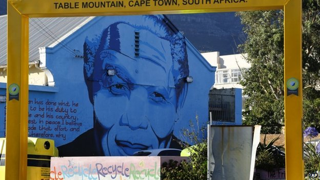 A mural of former South African President Nelson Mandela is painted on the wall of a building during his first dead anniversary in Cape Town, on 5 December 2013