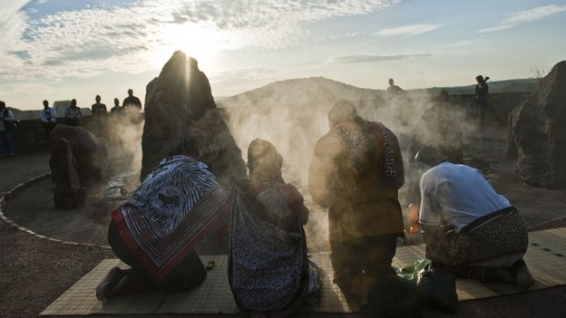 Traditional worshippers burn herbs in prayer at dawn at Freedom Park in Pretoria, South Africa, on 5 December 2014