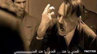 "Meme from a movie depicting Hitler saying  ""Sit down hind, siiiiiiiiit down"""