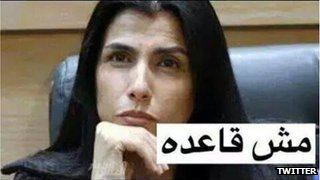 """A meme showing Hind Al Fayez with the caption """"I'm not going to sit down"""""""