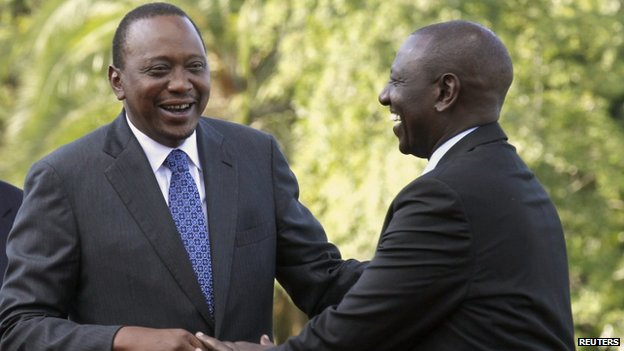 Kenyan President Uhuru Kenyatta (L) shares a moment with his Deputy William Ruto (R) at the State House after Kenyatta's case at the International Criminal Court (ICC) was dropped in the capital Nairobi